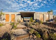House in the Mexican highlands with rammed-earth walls made from soil excavated on site