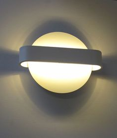 Modern yet functional. The Tokyo Wall light is an ultra-modern fitting that is ideal for creating ambient light in a room.  The low energy, long life LED chips project light out of the round shape base, and the horizontal piece spreads the light against the wall.  Mount multiple to the wall to achieve desired effect.