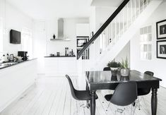 the floors in this modern kitchen. Interior Styling, Interior Decorating, Interior Design, White Wood Kitchens, Modern Kitchens, Dark Blue Walls, Küchen Design, White Houses, Scandinavian Interior
