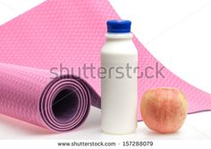 Yoga mat with milk and apple on white background - stock photo