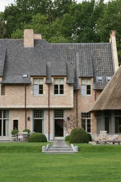 One mansion, three variations of roof tiles, Belgium