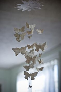 A shower of butterflies with rich vocabularies flutter down from a large star. This mobile measures approximately 24 inches in length, is made from vintage dictionary pages, vintage french magazine pages, and a recycled record jacket and is magical hanging in a doorway, a corner, or wherever you wish.