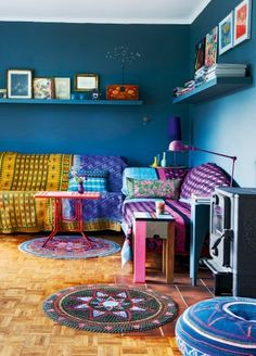 Textiles pop against dark walls.
