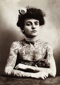 Maud Wagner 1877-1961. In 1900, tattooing was rarely seen in public except in circus sideshows. While a merchant seaman, Gus Wagner met tribesmen in Borneo & Java who taught him traditional tattooing. After covering his body with illustrations he promoted himself in traveling sideshows & circuses. At the St. Louis Worlds Fair (1904) he met & married Maud Stevens, a circus performer, who became one of the first female tattooists in the US.