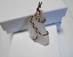 Copper / Sliver coated copper wrapped sea glass. Sea glass is clear color.