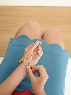 Put bracelets on by yourself using a paper clip.