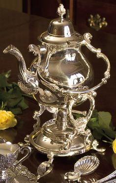 Elegant Tipping Teapot for a Formal Tea Time