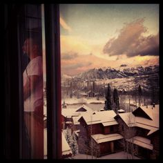Mike is worried...we are snowed in...his reflection as he overlooks the mountains from our condo window.   Telluride CO