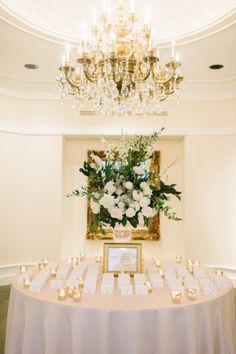 Glam escort card table: http://www.stylemepretty.com/little-black-book-blog/2015/03/11/classic-elegance-at-trump-winery/   Photography: L. Hewitt - http://landmhewitt.com/