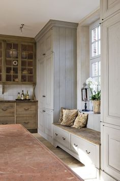 Great use of space around and between windows near kitchen. Adds space for pantries etc.