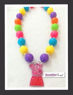 Our Peppa Pig Inspired Rainbow Bubblegum Bead Necklace with purple, yellow, teal, pink and green beads and featuring a rhinestone peppa pig pendant is just $18 including shipping (untracked) anywhere in Australia. More designs available at www.bubblegumroyal.com