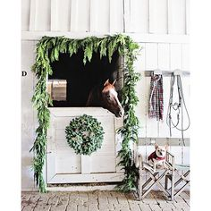 """One more from yesterday.  Wreath and garland are from @wintersteenfarms. Dually and Ivy trying to be good for us :). I'll be listing the vintage French bridle rack in the shop this next week."" Photo taken by @dreamywhiteslifestyle on Instagram, pinned via the InstaPin iOS App! http://www.instapinapp.com (12/13/2015)"