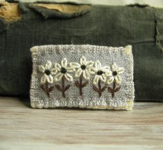 Inspiration - Again with the scarf idea along the edge, white on white  |Flower Brooch - White Daisies Hand Embroidered on Gray Linen