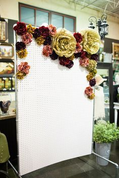 Paper flowers on pegboard