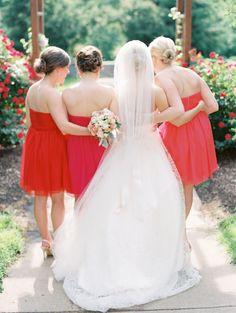 Bridesmaids in flame & fuschia. #LoveLaneLooks