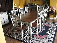 Take an old oak table and adding paint to the legs and chairs