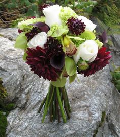 Perfect for October, Burgundy, green and white wedding flowers, with the burlap holder