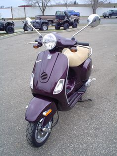 Modern Vespa : Daring Plum LX150 -- sadly, this color, which I've had my heart set on for a little while, is no longer available (new). I'd have to find it used and ship it to SF, CA.