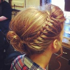 one sided french braid with a messy bun
