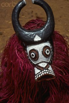 Africa | A Bobo wears a buffalo mask and costume of vegetable fibre in an agricultural religious festival in Burkina Faso | Image and caption © Charles & Josette Lenars