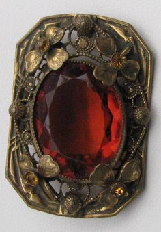 vintage brooch with large orangey stone http://vintagecollector.ca/