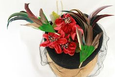 Vintage 1940s-Style Black Wool Felt Tilt Topper.  Whimsical hat scene consisting of two vintage faux hummingbirds zooming around a bouquet of vintage red velvet flowers.  Hat veiling is vintage 1940s fancy patterned veiling, and hat body is constructed of vintage black wool felt.