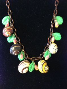 VINTAGE BAKELITE UNSIGNED NECKLACE WITH SNAILS, LEAVES & BERRIES DESIGN