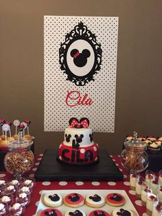 Backdrop and desserts at a Minnie Mouse birthday party! See more party ideas at CatchMyParty.com!