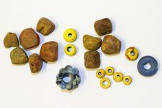 Cliffs End - beads 1    Amber and glass beads from the Saxon burials at Cliffs End.    For more information visit www.wessexarch.co.uk/projects/kent/ramsgate/cliffs_end/