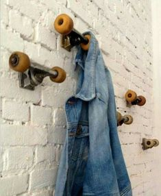 Porte manteaux... ...Repinned .... In modern French I believe 'porte manteaux' means coat rack. And it would appear that roller skates were used to make these.