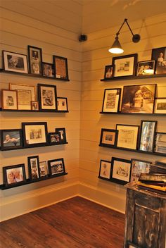 children's family photos on display in hallway, low level