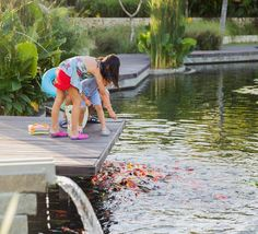 For a fun family activity, young guests at The Ritz-Carlton, Bali always enjoy feeding the fish in our koi pond.