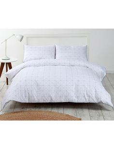 Featuring a subtle diamond pattern detail the 100% cotton Your Home and Garden Sidra Duvet Cover Set will be a sophisticated addition to your bedroom.