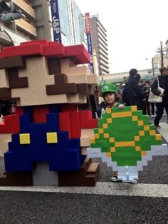 8-Bit Mario Cosplay With Little Luigi