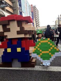 8-Bit Mario Cosplay With Little Luigi