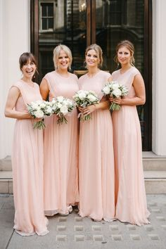 Bridesmaids in long, peach-colored dresses from Topshop. Ann Kathrin Koch photography.
