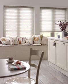 Soften up your entryways with Premier Flat Sheer Shades by Blinds.com, featuring flat 2-layer fabrics (sheer and private sections) that overlap for a modern look. Comes standard with a color-coordinated headrail.