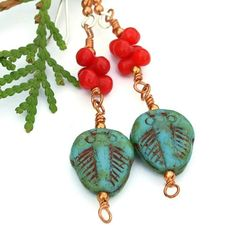 """A super fun pair of """"fossil"""" trilobite earrings, the ANCIENT DAZE handmade beauties were created with Picasso finish turquoise Czech glass trilobite beads, red coral barbells, copper and sterling silv"""