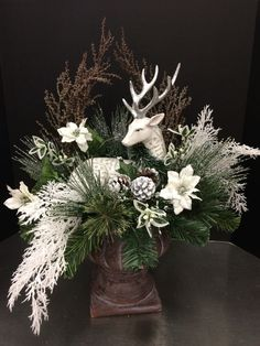 Elegant Winter Centerpieces Ideas You Can Try For Your Christmas Christmas Flower Arrangements, Christmas Flowers, Noel Christmas, Rustic Christmas, Christmas Projects, Winter Christmas, Christmas Wreaths, Winter Floral Arrangements, Advent Wreaths