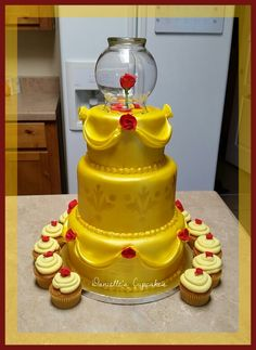 Beauty and the beast cake.  Everything is edible except glass topper!