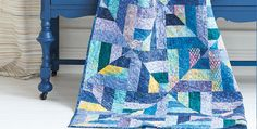 It Will be Wonderful in Other Colors, as Well! Batiks in a range of beautiful blues come together to make a gorgeous quilt. It's an easy one too, especially when made with pre-cut 2 1/2″ strips. The subtle patterning of batik fabrics gives the quilt depth and texture. Bits of lavender, yellow and magenta add …