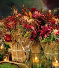 I think these are really pretty! I like the idea of wheat in the centerpieces. It definitely provides that country rustic feel.