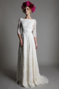 Wedding dress by Halfpenny London | British bridal fashion by Kate Halfpenny | Lace, Long sleeved lace, boat neck, Lace train, wedding dress, bridal, floral head dresses,