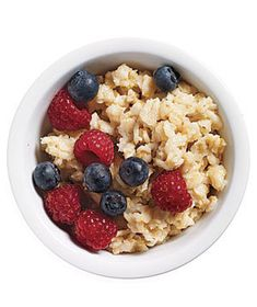 Small bowl of plain oatmeal topped with fresh berries and a splash of skim milk. | They're under 200 calories, healthy, satisfying, and pro-approved―what's not to love?