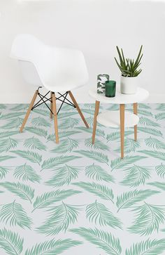 Hawaii is a Green Tropical Leaf Vinyl Flooring design that features a bright, fresh leaf pattern as a modern, minimalist take on interior design's prominent obsession with tropical trends.