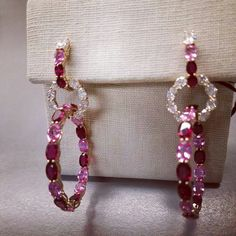 In and out hoops. Four prongs setting, 18kt yellow gold. Rubies are set on the inside and outside the hoops. Oval diamonds on top makes these earrings very comfortable to wear. #robertprocop