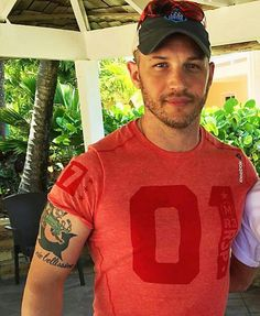 I thought that was an Ohio State shirt and almost peed myself. It's not. He's still handsome.