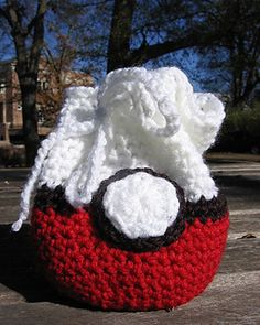 POKEMON BALL BAG:  This is a simple pattern for a round bag with a flat bottom. When the sides are folded down, the bag will sit flat, like a bowl, allowing easy access to the items inside. .... Free pattern at Ravelry .....