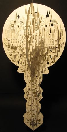 """""""NYT Key Magazine Ontwerp"""" - 3-D paper cut art by Ingrid Sikiakus;  """"The Key artwork has four identical sides, each cut/folded out of a single sheet of paper. The first and fourth side are connected to each other by means of slits and tabs. This way the artwork can be loosened. When this is done, it is possible to fold the piece into a two-dimensional surface.""""   (2010)   60 x 30 x 30"""