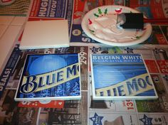 Mod podge beer box cutouts onto 4x4 tiles. Add felt to the bottom and you have DIY coasters. Great Father's Day/anniversary gift for your man